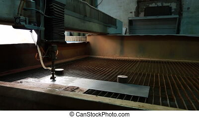 Waterjet cutting workshop View of running machine - Waterjet...