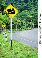 Steep grade hill traffic sign on road.
