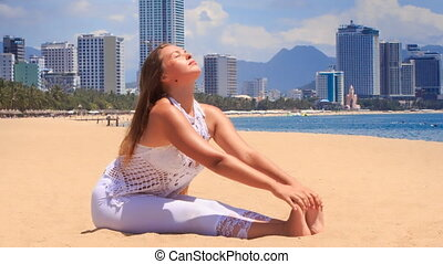 blonde girl in lace shows yoga asana forward bend - blonde...
