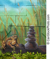 Big brown fairy-tale toad sitting on stone in grass, acryl...