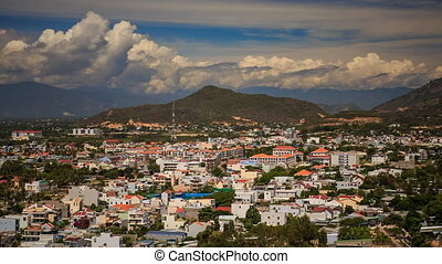 view of Vietnam resort city against mountains clouds blue...