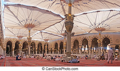 Nabawi mosque - MEDINA-MAR 08:Muslims rest and pray inside...