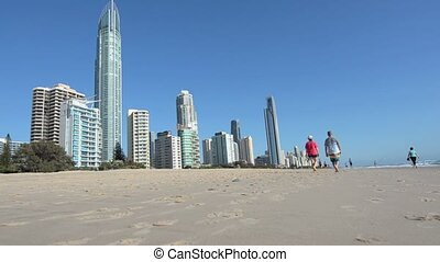 Visitors walks on main beach in Surfers Paradise Gold Coast...