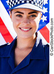 young policewoman - a young policewoman smiling