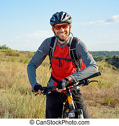 Portrait of Young Cyclist in Helmet and Glasses Sport...