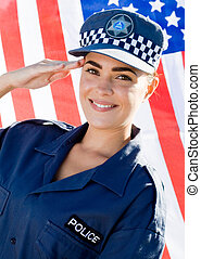 policewoman saluting - a pretty young policewoman in uniform...