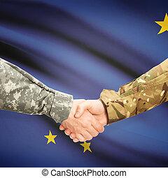 Military handshake and US state flag - Alaska