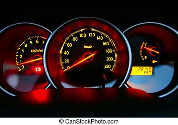 Car Dashboard - A shot of the car dashboard glowing while...