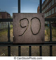Number 90 - number ninety engraved in plywood, attached to a...