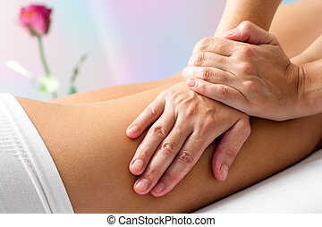 Detail of Hands massaging female hamstrings. - Close up...