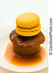 Sticky pudding dessert in a plate with caramel sauce with...