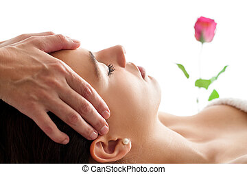 Woman having Facial massage isolated.