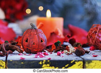 pumpkin on a background of dry plants and candles for...