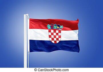Flag of Croatia flying against a blue sky