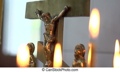 Crucifix and candles - Church candle on a background of the...