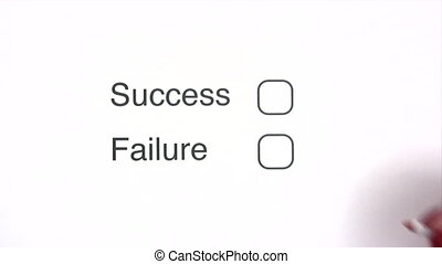 Failure - Hand with pen marking the FAILURE checkbox on a...