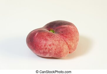 Saturn peach - A whole, medium-size, ripe, juicy saturn...