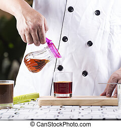 Pouring Syrup to cup of Tea