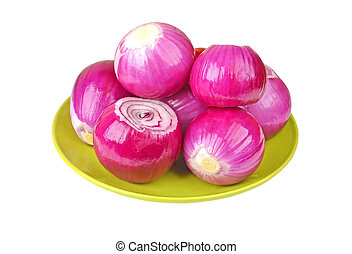 Peeled red onion on plate, isolated on white background