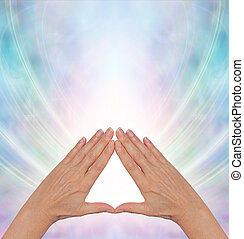 Pyramid Power Energy Healing - Female hands making a...