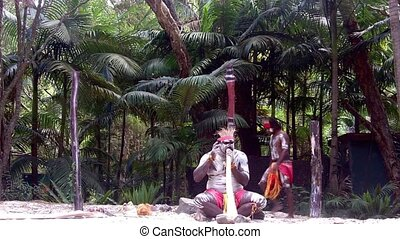 Aboriginal man play didgeridoo - Yugambeh Aboriginal man...