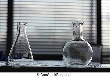 test tubes in dark laboratory