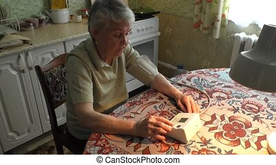woman takes arterial blood pressure - The elderly woman...