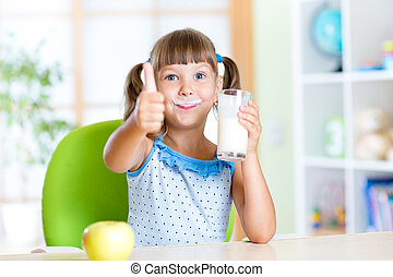 child drinks milk and showing thumb up