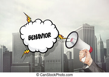 Behavior text on speech bubble and businessman hand holding...