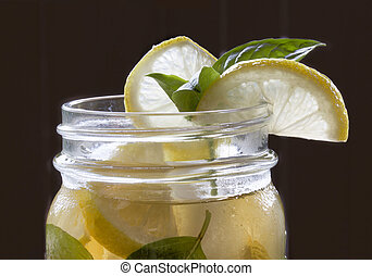 Iced Tea With Lemon - Iced tea with lemon wedge and sprig of...