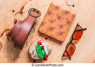 Leather accessories on wooden