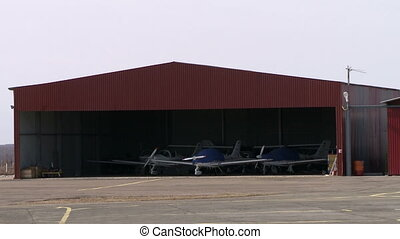 View of shrouded aircraft in hangar - View of shrouded...