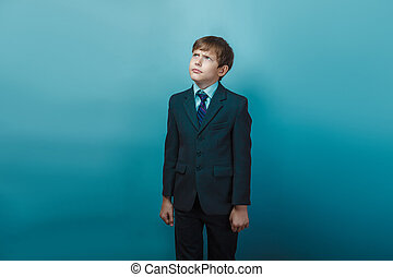 frowning - a boy of twelve European appearance in a suit...