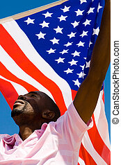 american pride - a proud american man holding the flag up in...