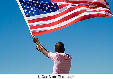 america - a man waving the american flag in sky
