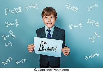 E=mc2 - a boy of twelve European appearance in a suit...