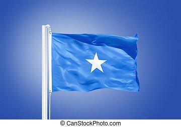 Flag of Somalia flying against a blue sky