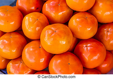alot of Persimmons fruit at the market