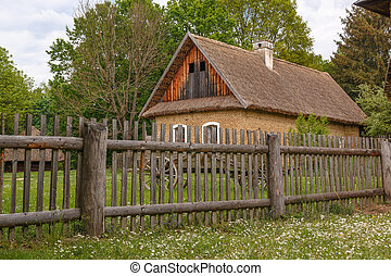 Rural house with wooden fence