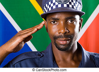 policeman saluting - a policeman saluting with south african...