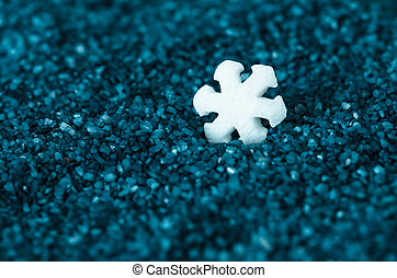 white snow flakes against black background