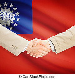 Businessmen handshake with flag on background - Burma -...