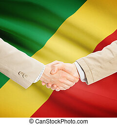 Businessmen handshake with flag on background - Republic of...