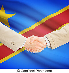 Businessmen handshake with flag on background - Democratic...
