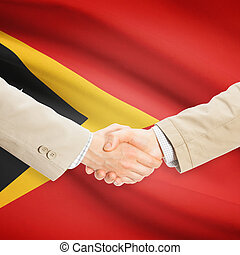 Businessmen handshake with flag on background - East Timor -...