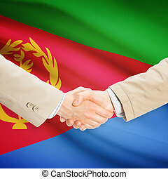Businessmen handshake with flag on background - Eritrea -...
