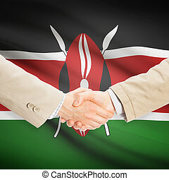 Businessmen handshake with flag on background - Kenya -...