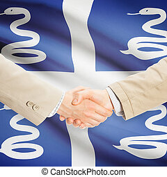 Businessmen handshake with flag on background - Martinique -...