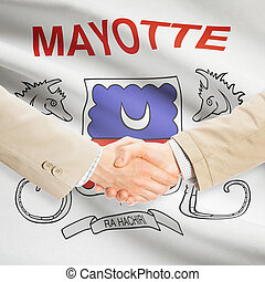 Businessmen handshake with flag on background - Mayotte -...