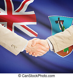 Businessmen handshake with flag on background - Montserrat -...